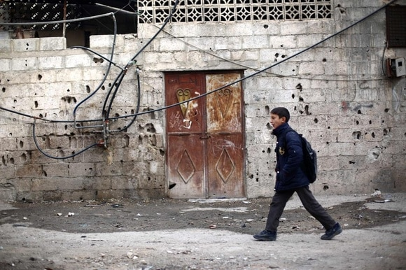 Syrian child in war-torn area of Damascus