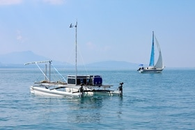 Catamaran on Lake Geneva and sailing boat