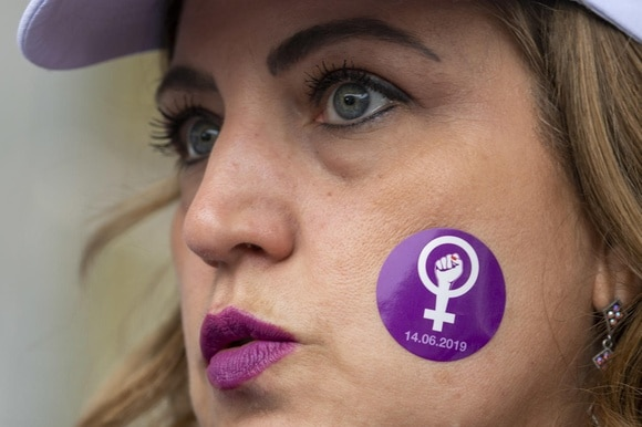 women with logo on face