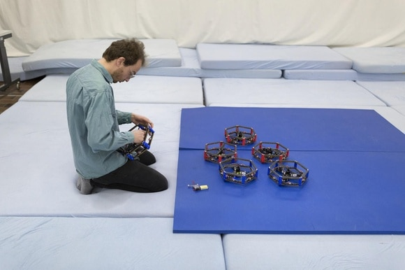 man testing drones in a lab environment