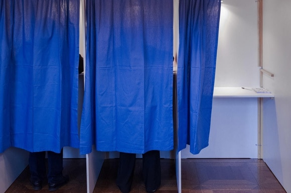 Polling booths with blue curtain