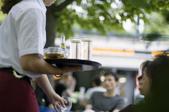 waiter serving drinks