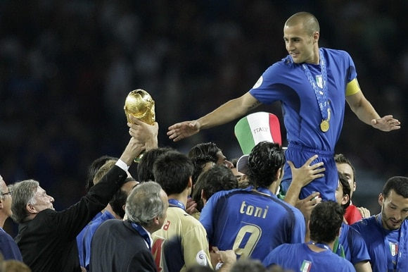 German president hands over the World Cup trophy to Italy s captain Fabio Cannavaro in 2006