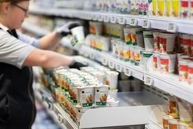 woman stocking yoghurt
