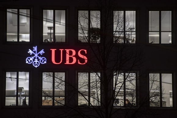 UBS sign on building in dark
