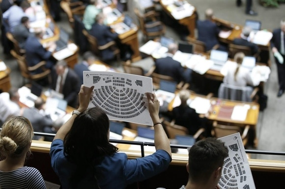 Woman checking seating plan in the Swiss parliament