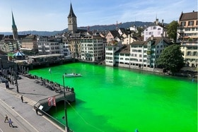 Around 30 demonstrators floated down the bright green river between the Münster and Rathaus bridges on Tuesday in protest.