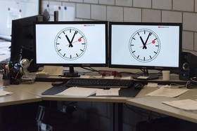 Two railway clocks on computer screens