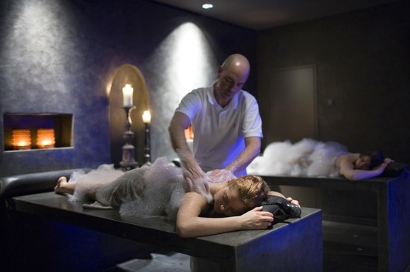 A woman gets a massage at the spa of a hotel