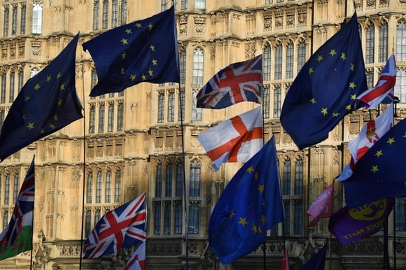 British and EU flags fly outside parliament in London