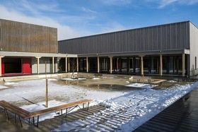 wooden building with snow on the ground