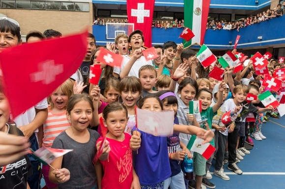 Children line up at the Swiss school in Mexico ahead of a ministerial visit in 2018