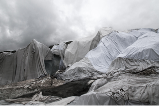 Glaciers draped with cloth.