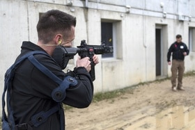 RUAG employees demonstrate an exercise rifle