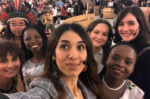 Nadia Murad and other young activists at the Geneva summit