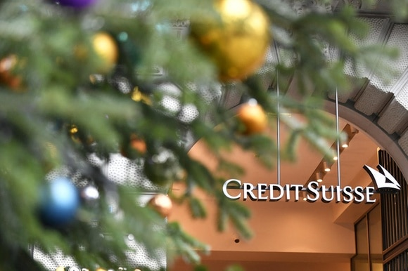 Credit Suisse sign framed by a Christmas tress