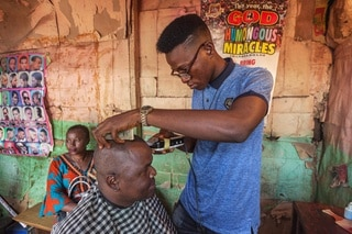 Father Gerald getting a hair cut