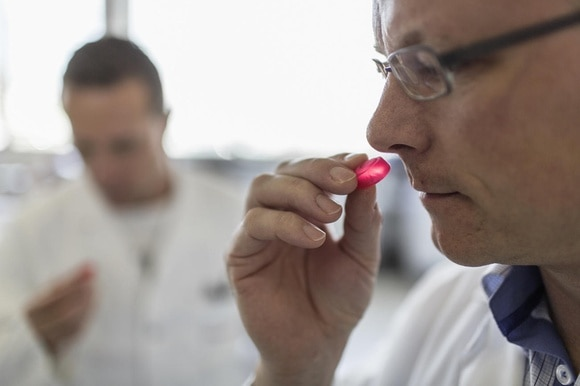 Employees test jelly sweets in the laboratory of fragrances and flavours manufacurer Givaudan.