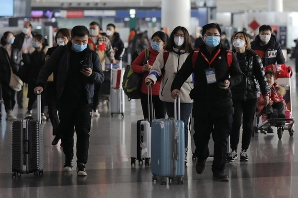 Passengers at Beijing airport on January 16, 2020