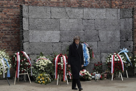 Switzerland s President Simonetta Sommaruga walks away after laying a wreath at the Death Wall at the Auschwitz