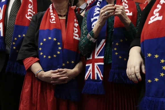 People wearing EU and Union Jack scarves