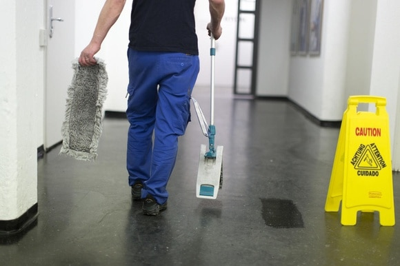 Man cleaning a floor