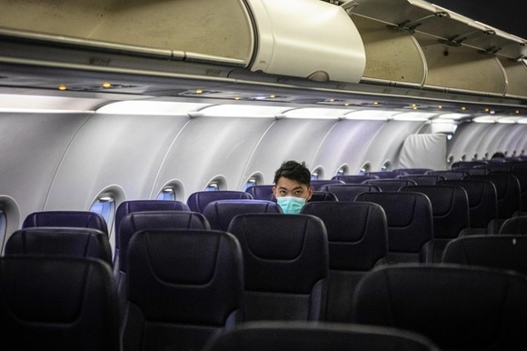 Man on his own in a plane