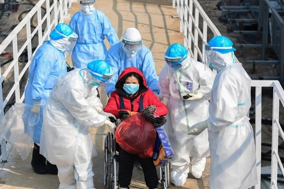 Medical staff transfer patients to the newly completed Huoshenshan temporary field hospital in Wuhan