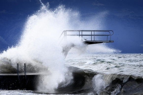 Waves hit a diving board during the Ciara storm on the shore of the Lake Geneva, in Lutry