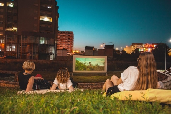 Kids watching open air film screening