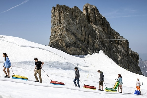 Tourists on the Titlis mountain in central Switzerland on June 26, 2019.