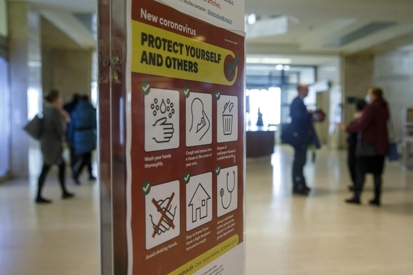 Information regarding the new coronavirus is displayed throughout the European headquarters of the United Nations in Geneva