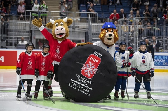 Ice hockey mascots on ice rink
