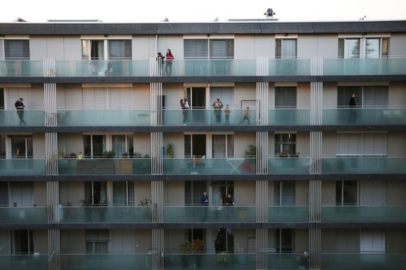 Residents on the balconies of an apartment building in Geneva during coronavirus outbreak