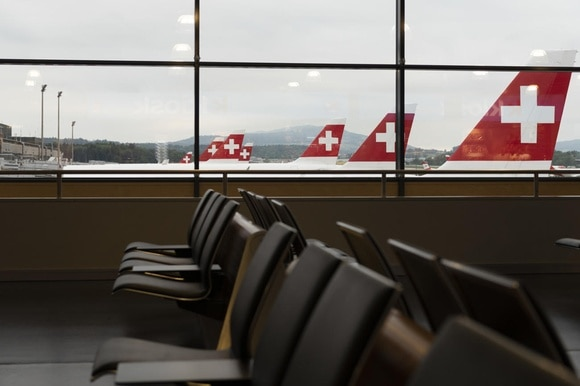 Planes by Swiss International Airlines and empty passenger area at airport