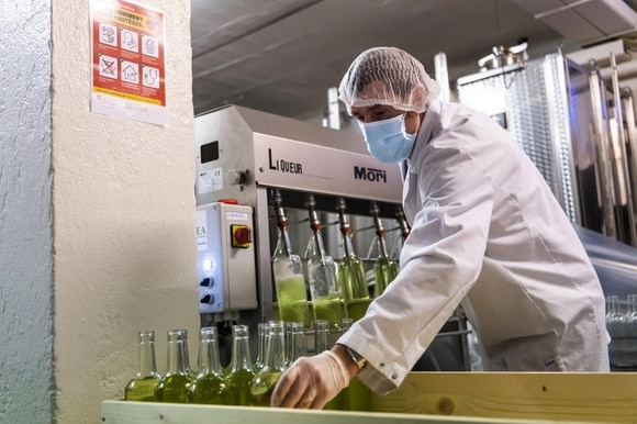A worker produces disinfecting hand gel