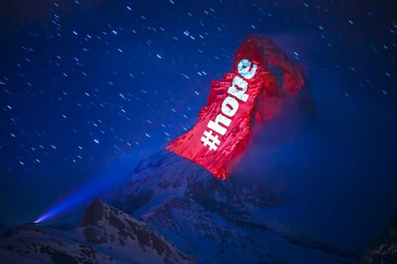 Matterhorn lit up with the message hope