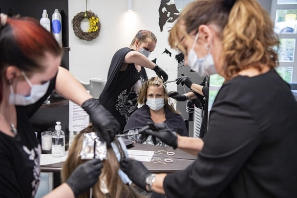 women wearing masks at the hair salon