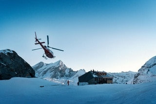 A helicopter flies to the Laemmeren hut, pictured on the Gemmi Pass above Leukerbad