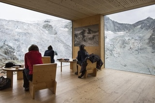 People enjoy the view of the Moiry Glacier the direction of the Moiry mountain hut