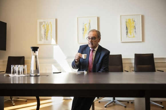 Economics Minister Parmelin in his office drinking cup of coffee