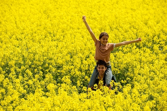 Two happy people in a field