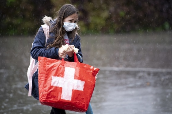 Girl with Swiss flag bag