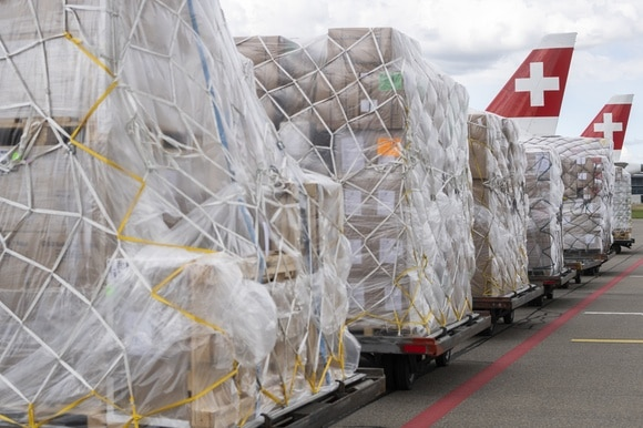 The relief supplies wait to be loaded onto a cargo plane at Zurich Airport