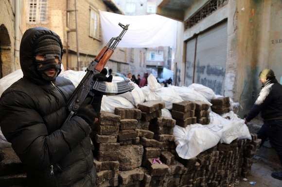 A PKK militant stands at a barricade in Diyarbakir, southeast Turkey (2016).