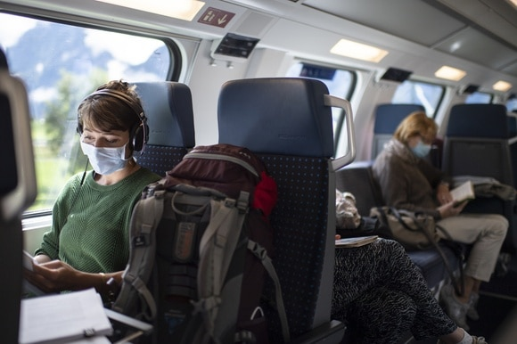 masked woman in train