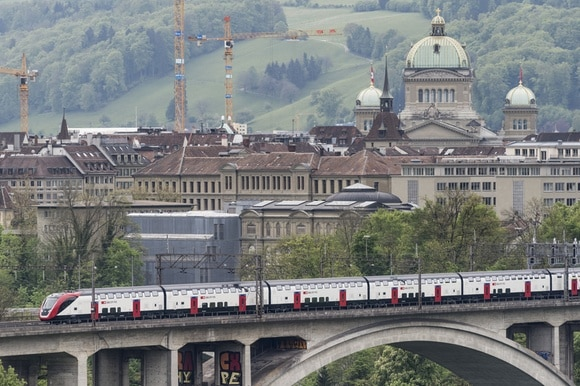 Double-decker train on a bridge