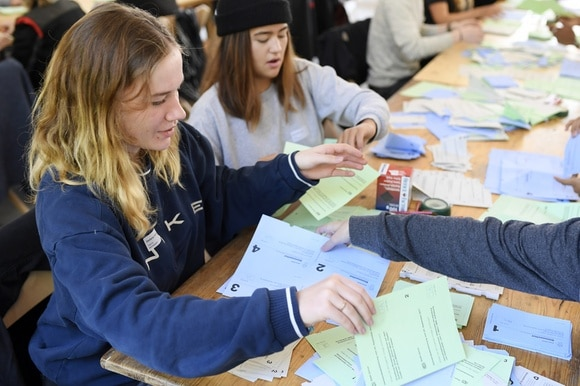 Yong people count votes in Switzerland