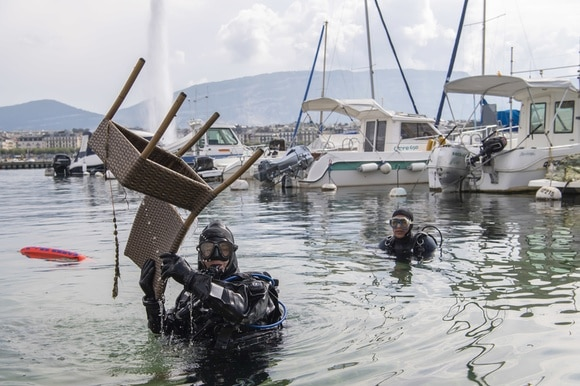Diver pulls a chair out of Lake Geneva