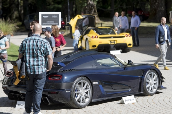 People look at expensive sports cars